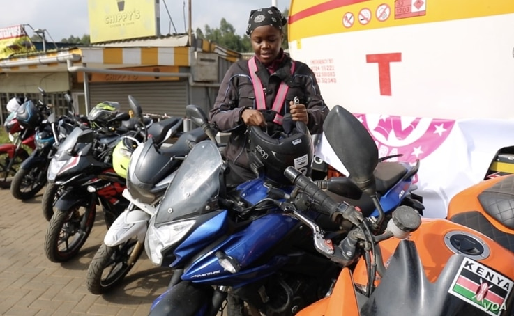 Demaris Mainis, an internet tech security analyst, rides because 'it's a way to set yourself free.' (Photo: A. Wangwa/VOA)