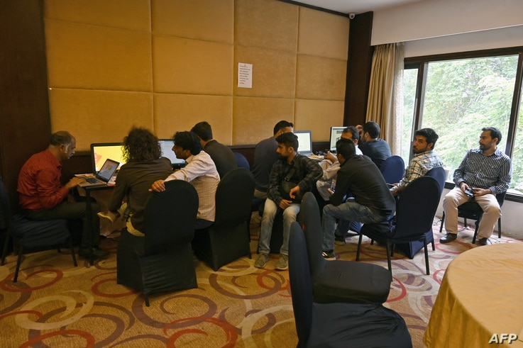 Journalists use internet facilities sanctioned by the authorities, amid strict communications restrictions, during a lockdown at a hotel in Srinagar, Oct. 3, 2019.