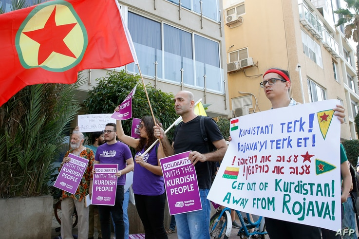 Israelis demonstrate against the Turkish military offensive in northeastern Syria on October 17, 2019 in front of the Turkish…