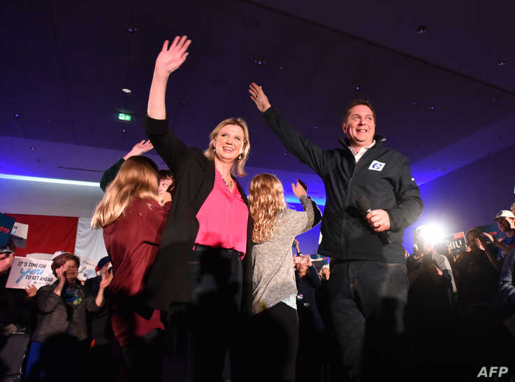 Andrew Scheer, Leader of The Progressive Conservative Party of Canada and his wife Jill, with two of their children, wave to the crowd at a rally in Richmond, British Columbia, Oct. 20, 2019.