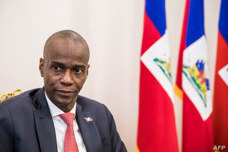 President Jovenel Moise sits at the Presidential Palace during an interview with AFP in Port-au-Prince, October 22, 2019. -…
