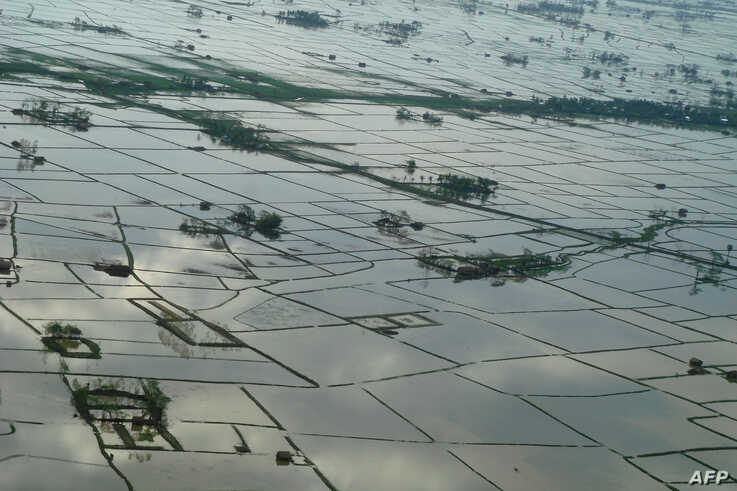 This recent handout photo received by UNICEF on May 21, 2008 shows fields inundated with water at an undisclosed location in…