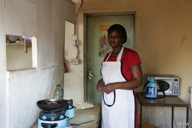 Regina Anyango owner of small food kiosk in Nairobi uses ethanol fuel to prepare meal for customers. Her kitchen is free fumes and smoke from Charcoal use.