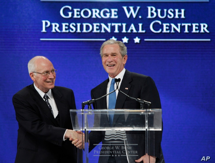Former President George W. Bush, right, shakes hands with former Vice President Dick Cheney after Cheney introduced Bush during…