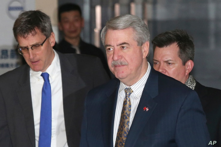 U.S. Undersecretary for Trade and Foreign Agricultural Affairs Ted McKinney, center, who is part of U.S. trade delegation…