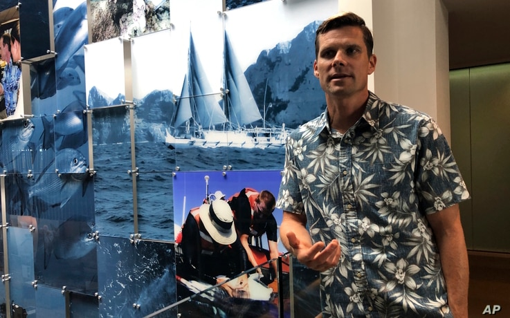National Oceanic and Atmospheric Administration oceanographer Jamison Gove talks about coral bleaching at the NOAA regional office in Honolulu, Sept. 16, 2019.