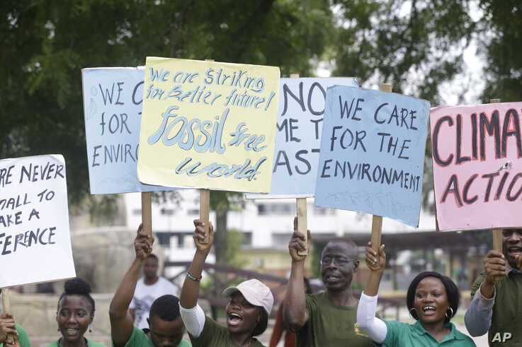 Protesters march to demand action on climate change, on the streets in Lagos, Nigeria Friday, Sept. 20, 2019. Protesters around…