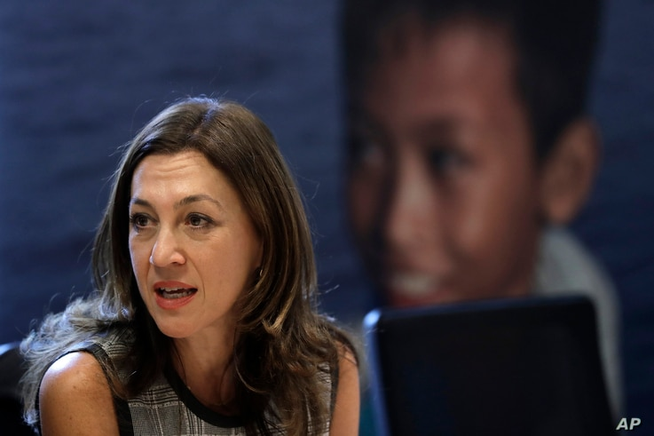 Eva Millona, of the Massachusetts Immigrant and Refugee Advocacy Coalition, participates in a roundtable discussion, Oct. 1, 2019, in Boston, on the impact of a cap on refugee admissions to the U.S.