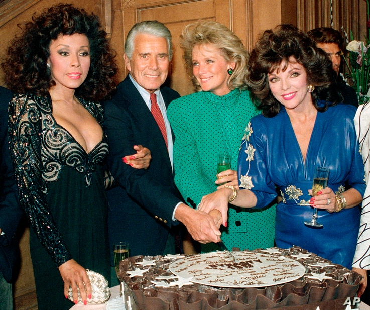 """FILE - This Sept. 24, 1986 file photo shows, Diahann Carroll, John Forsythe, Linda Evans and Joan Collins from """"Dynasty""""…"""