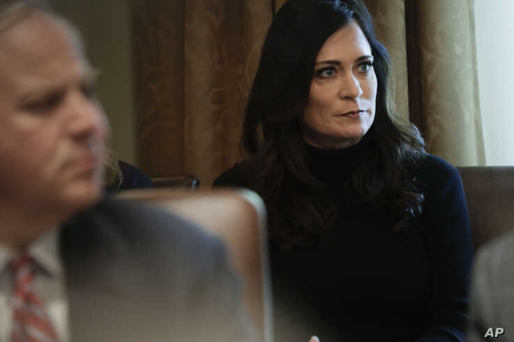 White House press secretary Stephanie Grisham listening to President Donald Trump during a Cabinet meeting in the Cabinet Room…