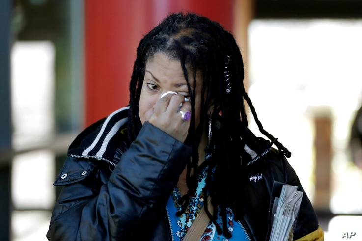 Katrina Hutton wipes tears as she leaves Gilliam Concert Hall after viewing the open casket of U.S. Rep. Elijah Cummings at…