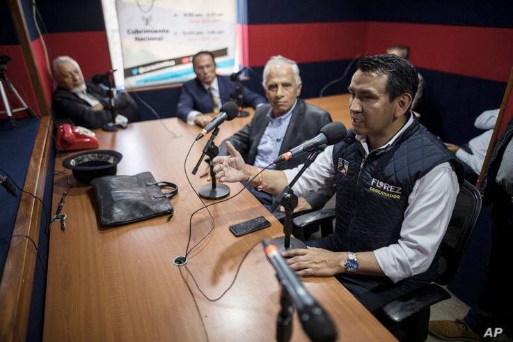 Wilson Florez, candidate of Democratic Center political party for the government of Cundinamarca, speaks at a radio station…