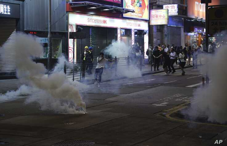 Tear gas engulf the streets of Hong Kong, Oct. 27, 2019.