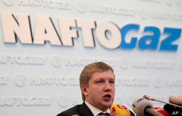 """Chairman of the board of the company """"Naftogaz"""" Andrew Kobolyev speaks during a news conference in Kiev, Ukraine, Friday, June…"""