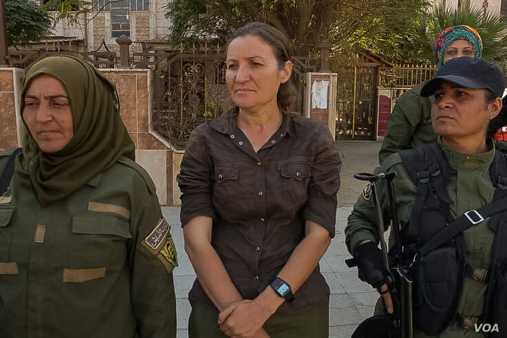 """Haval Heline, 34, says her troops will never give up, despite recent losses. """"We will fight for it until our last drop of blood,"""" she says. (Yan Boechat/VOA)"""