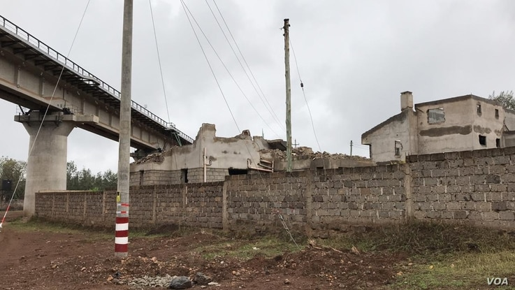 The railway line construction by the Chinese goes through people's lands and homes forcing the government to pay millions in compensation.