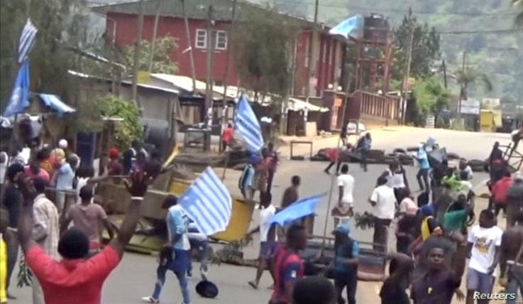 FILE - An image taken from a video shot Oct. 1, 2017, shows protesters waving Ambazonian flags in Bamenda, Cameroon. English-speaking Cameroonians celebrated what they call the 2nd anniversary of their independence day on Oct. 1, 2019.