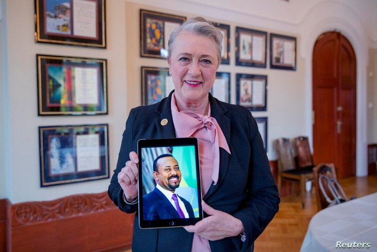 Chair of the Nobel Committee Berit Reiss-Andersen holds a picture of Ethiopia's Prime Minister Abiy Ahmed, whom she previously…