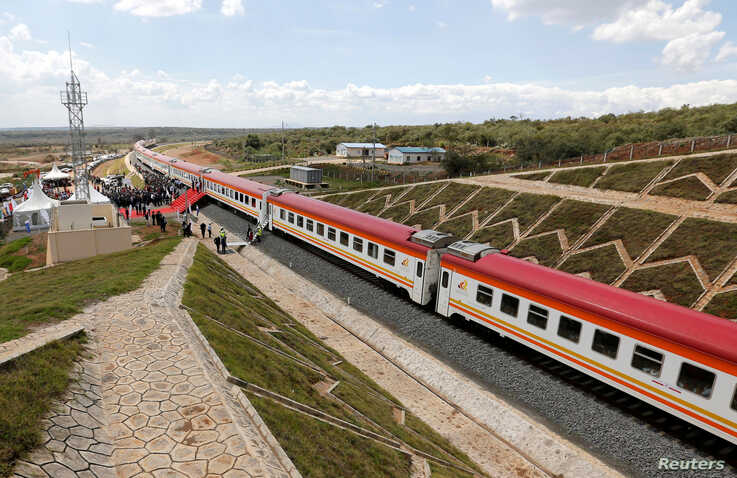 A general view shows a train on the Standard Gauge Railway (SGR) line constructed by the China Road and Bridge Corporation ...