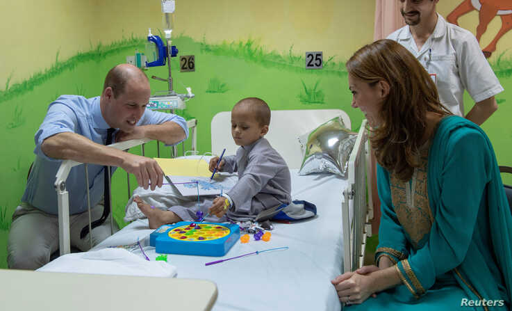 Britain's Prince William and Catherine, Duchess of Cambridge visit a 5-year-old Muhammed Sameer at the Shaukat Khanum Memorial…
