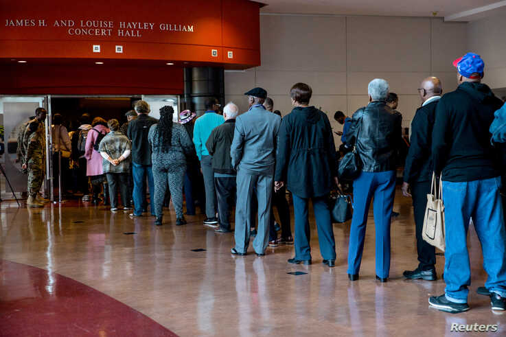 Mourners wait in line for the public viewing of late U.S. Congressman Elijah Cummings at Morgan State University in Baltimore,…