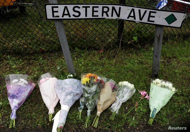 Flowers are seen at the scene where bodies were discovered in a lorry container, in Grays, Essex, Britain October 24, 2019…