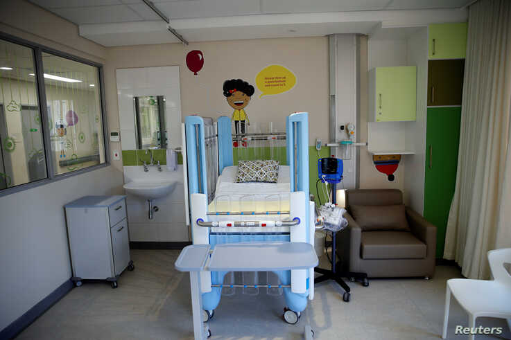 A pediatric hospital bed is seen at a ward during the official opening of the Nelson Mandela Children's Hospital in…