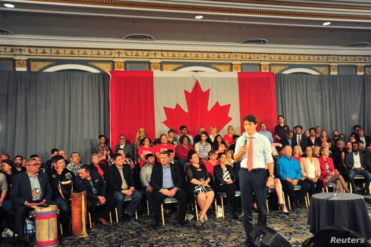FILE - Canada's Prime Minister Justin Trudeau answers a question about pictures of him in blackface during a town hall meeting at an election campaign stop in Saskatoon, Saskatchewan, Canada, Sept. 19, 2019.