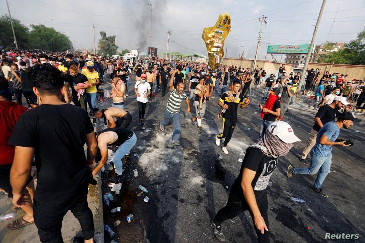 Demonstrators take part in a protest over unemployment, corruption and poor public services, in Baghdad, Iraq, Oct. 2, 2019.