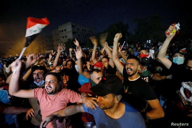 Demonstrators gather at a protest during a curfew, two days after the nationwide anti-government protests turned violent, in Baghdad, Iraq, Oct. 3, 2019.