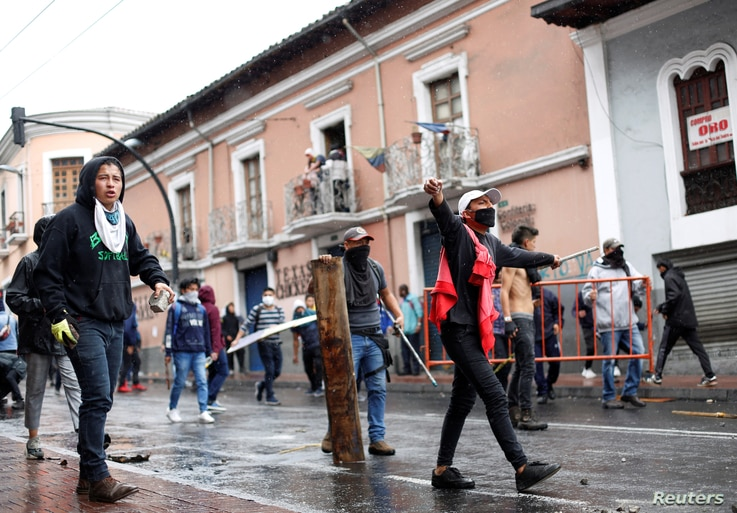Demonstrators clash with riot police during a protest after Ecuadorian President Lenin Moreno's government ended four-decade-old fuel subsidies, in Quito, Ecuador, Oct. 3, 2019.