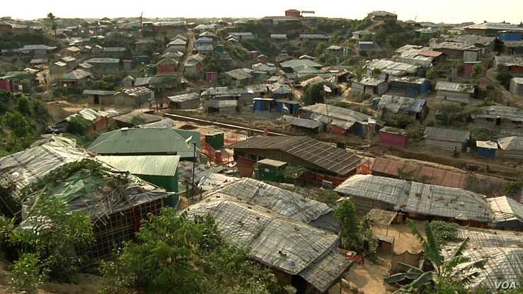 Aid groups say the strain of daily life in refugee camps in Bangladesh, in which refugees are not allowed to leave, adds to emotional stress. (Dave Grunebaum/VOA)