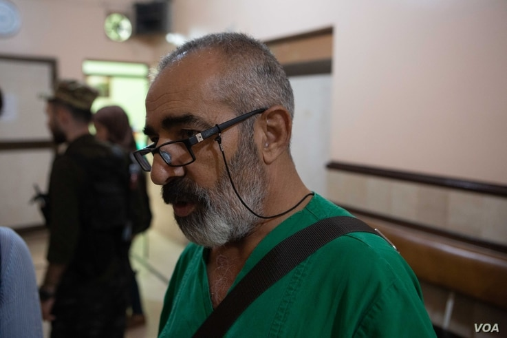 A doctor called Abu Hozan says he has been at his hospital for the past 10 days, sleeping only a few hours a night in an office short of equipment and medicine, in Qameshli, Syria, Oct. 20, 2019. (Yan Boechat/VOA)