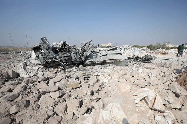 A destroyed vehicle at the site where helicopter gunfire reportedly killed nine people near the northwestern Syrian village of Barisha in the Idlib province, Oct. 27, 2019.