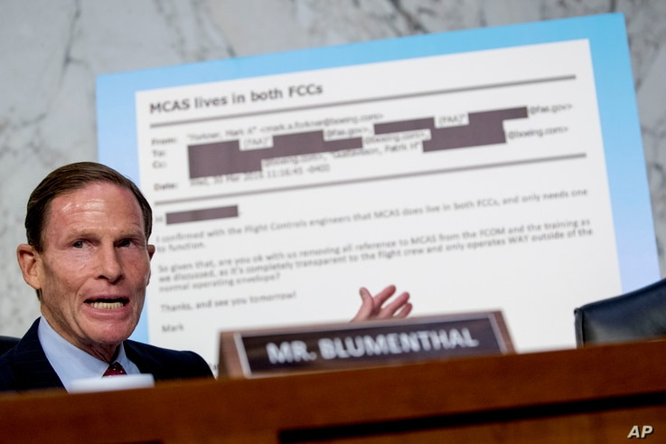 Rep. Richard Blumenthal, D-Conn., displays an email exchange behind him as he questions Boeing Company President and Chief Executive Officer Dennis Muilenburg as he testifies before a Senate committee hearing, Oct. 29, 2019.