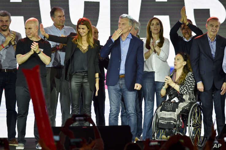 President Mauricio Macri, who was running for re-election, throws a kiss to supporters after conceding the election in Buenos Aires, Argentina, Oct. 27, 2019.
