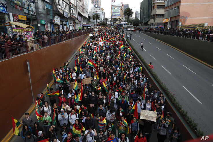 Anti-government protesters march demanding a second round presidential election, in La Paz, Bolivia, Oct. 24, 2019.
