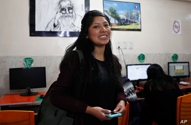 University student Clara Huanca, who is studying education, poses for a portrait at an internet cafe where she worked on a project with classmates in La Paz, Bolivia, Sept. 17, 2019.