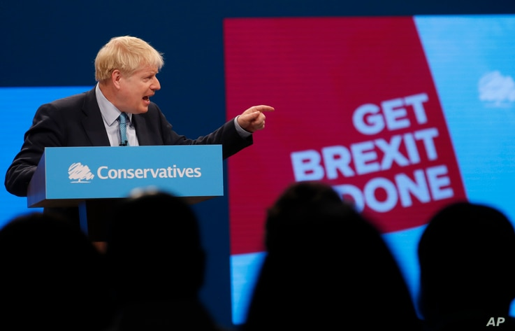 Britain's Prime Minister Boris Johnson delivers a speech at the Conservative Party Conference in Manchester, England, Oct. 2, 2019.