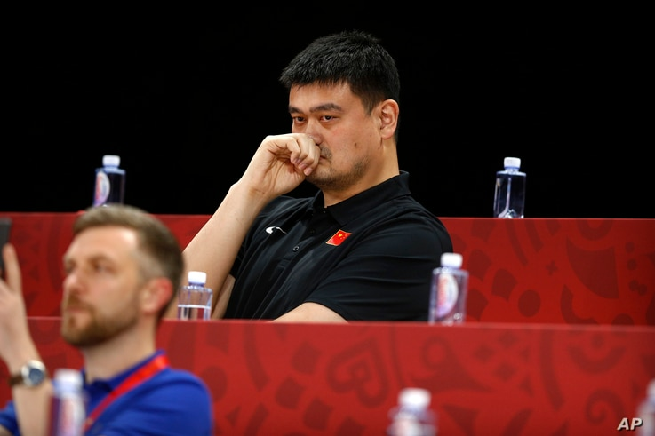 FILE - Yao Ming, head of the Chinese Basketball Association and former NBA player, watches as China and Venezeula compete during their group phase basketball game in the FIBA Basketball World Cup at the Cadillac Arena in Beijing, China, Sept. 4, 2019.