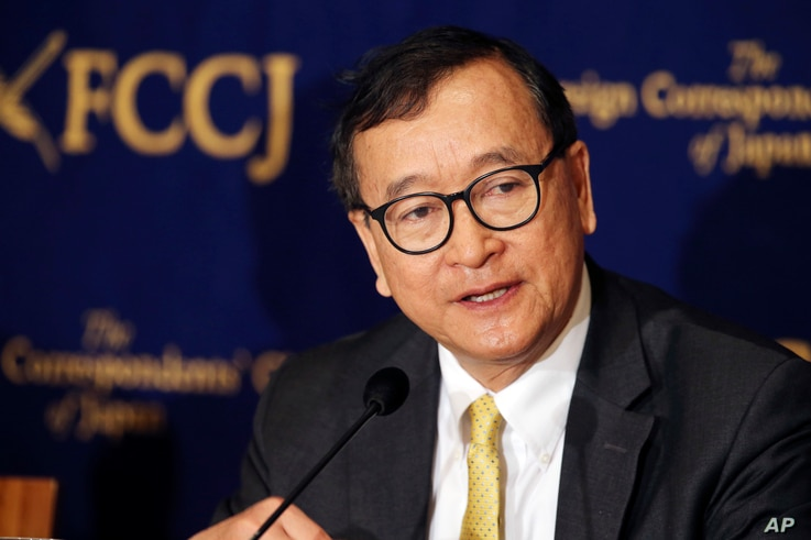 FILE - Cambodia's self-exiled opposition leader Sam Rainsy speaks during a press conference in Tokyo, Japan, April 13, 2018.