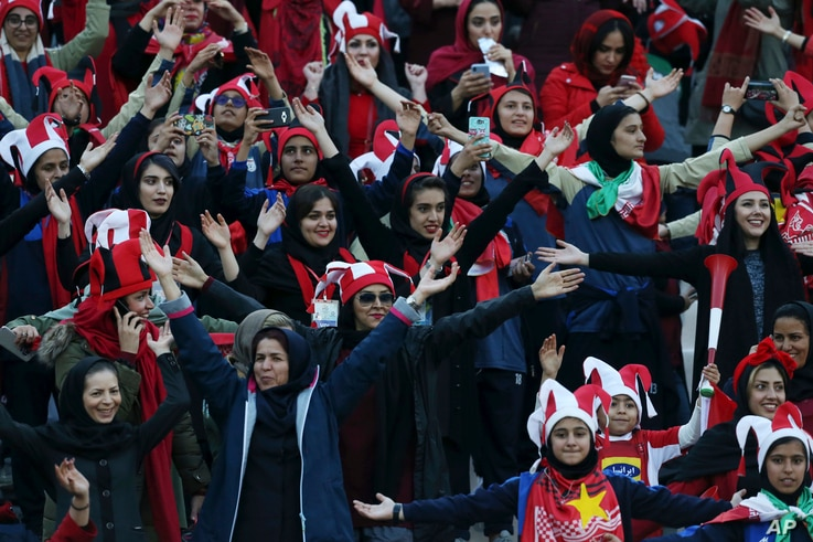 FILE -- Female Iranian spectators clap hands as they wait to start a soccer match between Iran's Persepolis and Japan's Kashima Antlers during the 2nd leg of the Asian Champions League finals at the Azadi (freedom) stadium in Tehran, Iran, Nov. 10, 2018.