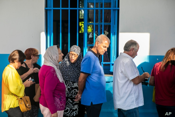 Voters queue outside a polling station during a parliamentary election in La Marsa, outside Tunis, Tunisia, Oct. 6, 2019.