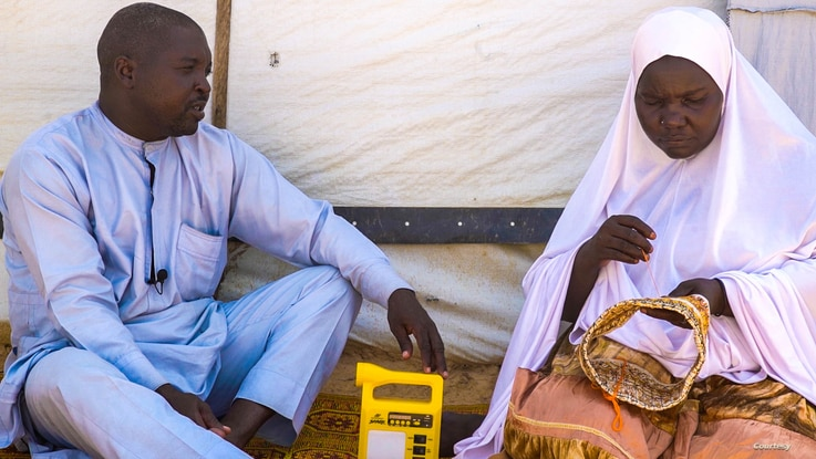 Abdulhamid Bala sits with his wife at Bakassi refugee camp. He's concerned about his father and younger brother who went missing about five years ago, in Maiduguri, Nigeria. (Courtesy - Simpa Samson)
