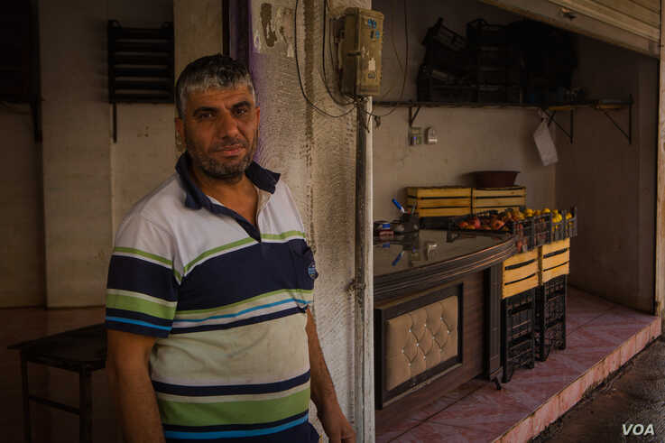 Mohammad, 39, sent his three children to stay with relatives ahead of the end of the cease-fire, but says he won't leave unless the city is bombed, in Darbasiyah, Syria, Oct. 22, 2019. (VOA/Yan Boechat)