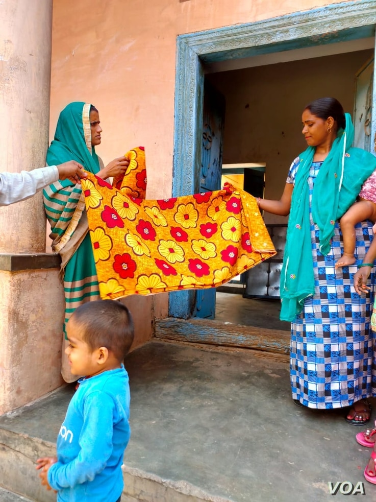 Women in Kasan, india  benefitted from growing family incomes as migrant workers brought an economic boom.