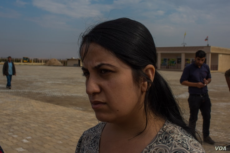 Nasreen Ali, 25, says the chaos in northeastern Syria is terrifying, with no clear information coming from any government involved, near Tal Tamer, Syria, Oct. 21, 2019 . (Yan Boechat/VOA)