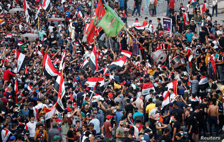 Demonstrators take part in a protest over corruption, lack of jobs, and poor services, in Baghdad, Iraq, Oct, 26, 2019.