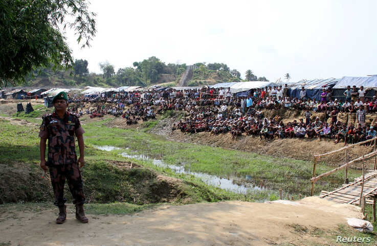 FILE - A Bangladeshi soldier stands guard near a refugee camp in Cox's Bazar, Bangladesh, housing Rohingya refugees from Myanmar's Rakhine state, April 29, 2018.
