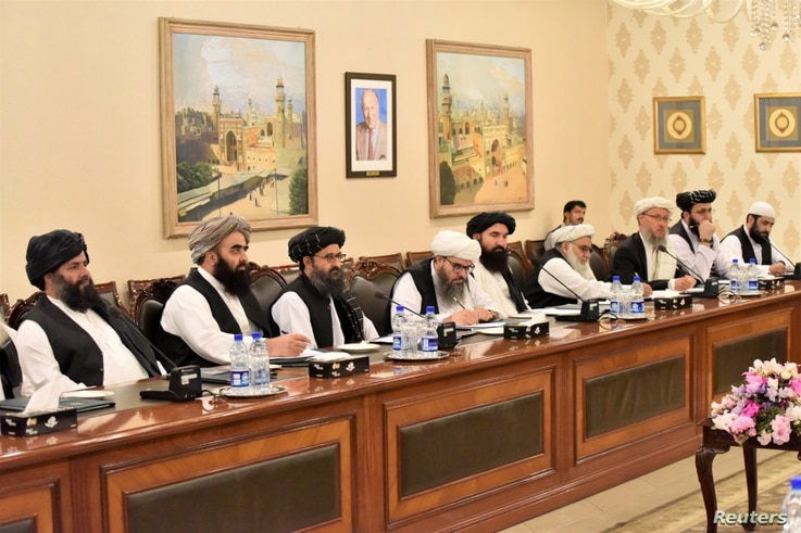 Mullah Abdul Ghani Baradar (3rd-L), who is leading a Taliban delegation, attends a meeting at the Ministry of Foreign Affairs in Islamabad, Pakistan, Oct. 3, 2019.